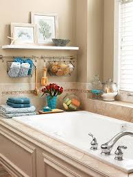 image bathtub decor: keeplinensandspongesnearbywithwirebasketsthathangabovethebathtubonminiaturetowelrodsafloatingshelfcreatesspacetoshowcaseartwork   keeplinensandspongesnearbywithwirebasketsthathangabovethebathtubonminiaturetowelrodsafloatingshelfcreatesspacetoshowcaseartwork