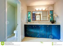 blue painted bathroom vanity plywood board wooden vanity cabinet in light blue bathroom stock photo image