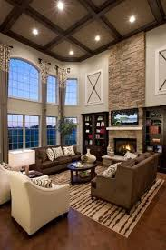 contemporary living room with box ceiling hardwood floors high ceiling arched window built in living room furniture