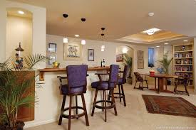 walk behind seated wet bar with wood top and pendant lighting arched top vase niche bar top lighting