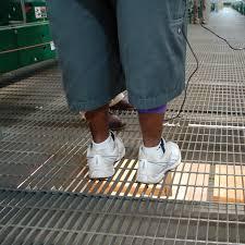 standing on a bar grate floor bar grate mezzanine floor