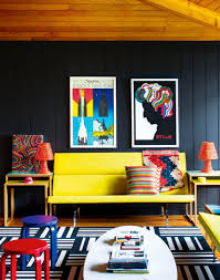 royal blue paint color for boho chic living room with a yellow sofa and patterned pillows decorated with paintings and rug chic yellow living room