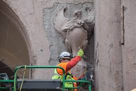 culture archives crosscut culture a worker readies one of the remaining gargoyles for safe removal on friday 31