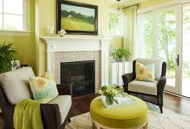 warm living room ideas: light green warm living room decorating ideas with framed wall art and wicker chairs and ottoman
