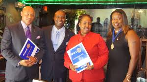 stories rotary club of south east nassau president bridgette inducts two new rotarians the sen family welcomes rotarian aniska russell and rotarian lionel haven