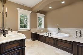 ideas bathroom tile color cream neutral: bathroom with warm brown walls and moldings with porcelain tile flooring and white granite countertop