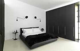 view in gallery minimalist bedroom in black and white accentuated by serge mouille rotating sconces bedroom sconce lighting