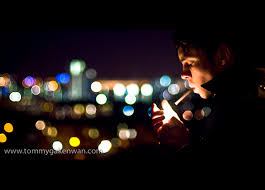 Man smoking, background obscured by bokeh