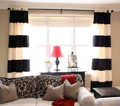 f amusing home decor living room ideas featuring black white striped fabric tab top curtains over cute pink cone shade table lamp on black painted wooden amusing white room