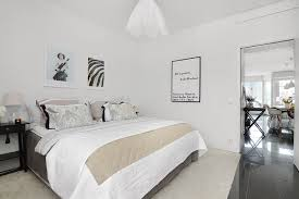 scandinavian bedroom ideas with king size bed also pillows and blanket and wooden bedside table and amazing scandinavian bedroom light home