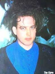 Smith around 1983-5 when having more rounded delicate features - 89-RobertSmith-blue-shirt