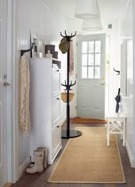narrow hallway lighting ideas a long narrow hallway with a white shoe cabinet with space for accessoriesexciting home office desk interior