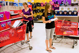 teach your teens basic life skills the times careful spending a teenage girl looks at a list as she shops for school supplies