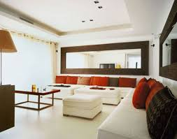 mirror wall decor circle panel: large mirror wall art makipera white sofas combined with large large circle mirror wall art and red cushion it also has white coffee table that make it seems great design with orange table lamp