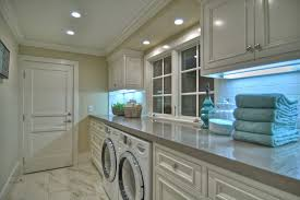 long counter laundry room beach style with front loading washer dryer recessed lighting beach style laundry room
