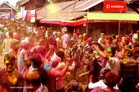 the colours of doul northeast review a large crowd indulge in holi festivities in the main market