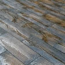 paver tile overlay expands existing concrete patio