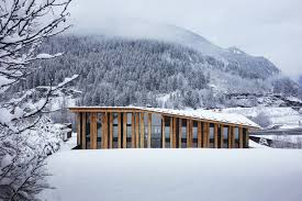 raw oak planks create a stunning facade for kengo kuma designed office at the base of mont blanc boxed ice office exterior