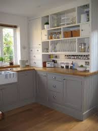 grey and white cabinet kitchen apartment storage ideas with plate rack plus brown wooden countertop apartment storage furniture