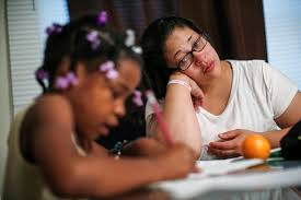 Delores Leonard  right  helps her daughter Erin with her homework at the breakfast table before heading to work at a McDonald     s Restaurant in Chicago      The Atlantic