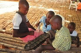 Resultado de imagen de africanos jugando aljuego mancala