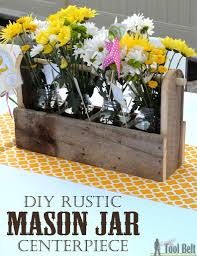 this mason jar caddy makes a perfect rustic centerpiece paint the jars to change it build diy mason