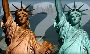 The <b>changing colors</b> of the Statue of Liberty