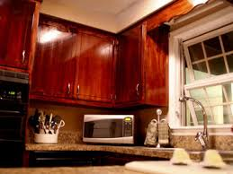 Diy Staining Kitchen Cabinets How To Give Your Kitchen Cabinets A Makeover Hgtv