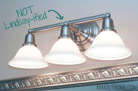brushed nickel builders grade bathroom vanity light via makelyhomecom bathroom vanity lighting bathroom