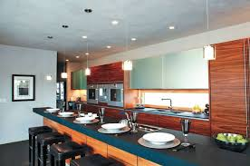 the kitchen in this photograph combines recessed can lights pendant lights and under cabinet cabinet lighting flip