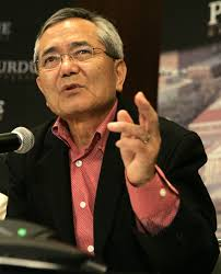 Chemistry professor Ei-ichi Negishi gestures as he speaks during a news conference after he was ... - Ei%2Bichi%2BNegishi%2BPurdue%2BProfessor%2BEi%2Bichi%2BNegishi%2BswhbVLwueuQl