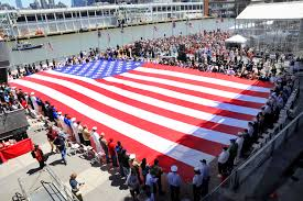 u s department of defense photo essay service members and veterans hold a 100 foot american flag unfurled during the intrepid sea