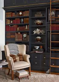 home office library with black built in bookcases design rob stuart photo francesco atherton library traditional home office