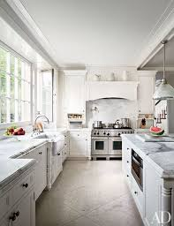 white kitchen windowed partition wall: white kitchen marble countertop apron front sink
