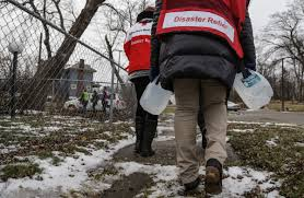 flint water crisis a visual essay a community responds red cross volunteers trek across the city in 2016 to deliver jugs of purified water to residents in neighborhoods most affected by lead