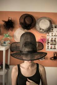 in conversation floyd manotana a soweto based fashion at ms folake s millinery shop trying out the wusha meets v for vendetta inspired silhouette