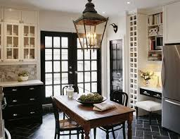 here a vintage marble topped wood table and black bentwood chairs anchor a modern space black bentwood chairs