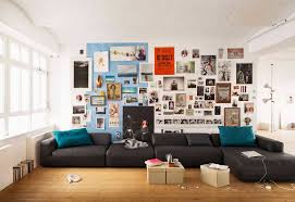 vivacious living room with black rolf benz sofa in modern shaped design made from glossy fabric blue angel rolf benz entire collection