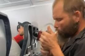 Man lights cigarette and starts <b>smoking</b> onboard flight in US | The ...