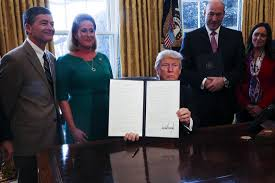 goldman sachs news photos quotes wiki com trump signs executive order to scale back wall street regulation