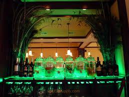 oregon bar wtih color changing rgb flexible led strips lighting up the glass bar shelving for bar lighting ideas