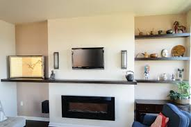 beauteous image of living room decoration using mount wall black wood shelf over fireplace including black wood floating shelves in living room and navy beauteous living room wall unit