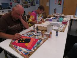 mrc provides jobs for artists disabilities mental illness wmuk two mrc artists working on their paintings for this week