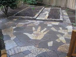 stone patio installation:  rock n dirt yard flagstone patio