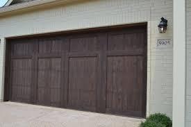 Village Homes Wood Cedar Garage Door Stained In A Dark Brown A - Exterior garage door