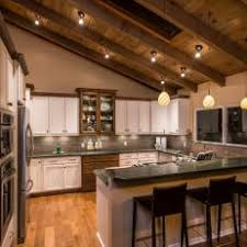 spacious kitchen with country accents and vaulted wood ceiling spacious eat kitchen