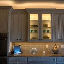 above cabinets glass cabinets and lighting on pinterest above kitchen cabinet lighting