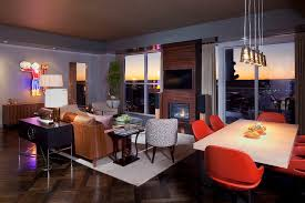 modern living room modern living room idea in austin with blue walls and dark hardwood floors blue dark trendy living room