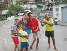 Volunteer work leads to master     s thesis for Brock student     The     Master     s student Ashley Hobden with children in a favela or shanty town in Rio de Janeiro