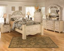 bedroom set main: signature design by ashley saveaha queen poster bed royal furniture headboard amp footboard memphis jackson nashville cordova tennessee southaven